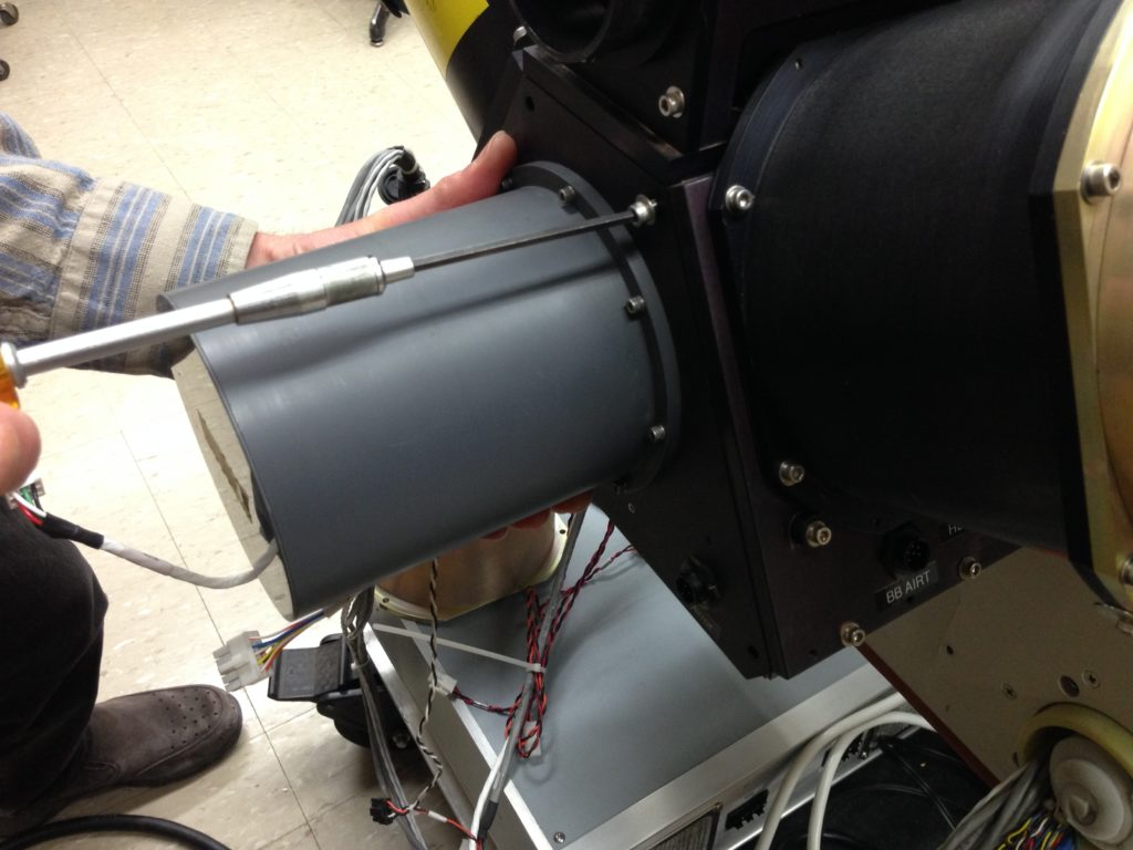 Figure 1: Unscrewing the mirror:motor assembly