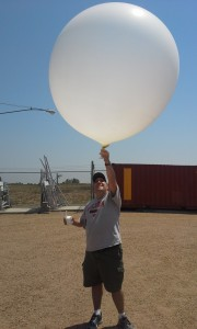 SSEC's John Lalande launching a radiosonde at the BAO in support of FRAPPE.