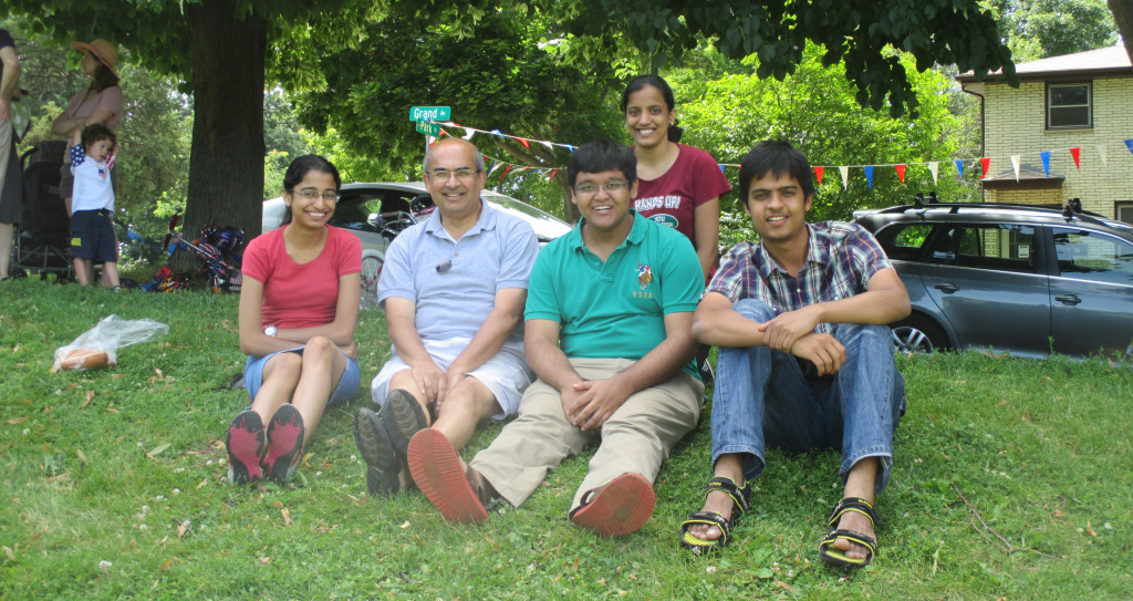 SSEC scientist and mentor Sanjay Limaye sits with the four university students from India conducting research at UW-Madison this summer through the S.N. Bose Scholars Program, which is in its second year.