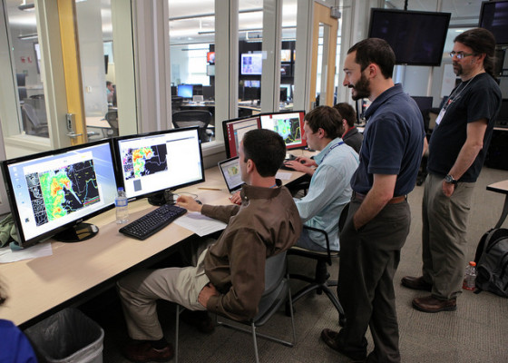 CIMSS scientist John Cintineo stands by while forecasters attending NOAA's Hazardous Weather Testbed try out the ProbSevere statistical model. The model added at least 10 minutes of lead-time to severe weather warnings more than half of the time at the test-bed this summer. Credit: James Murnan, NOAA.