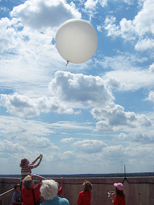 A balloon launch on the Atmospheric, Oceanic, and Space Sciences rooftop during Grandparents University in 2008. Credit: SSEC.