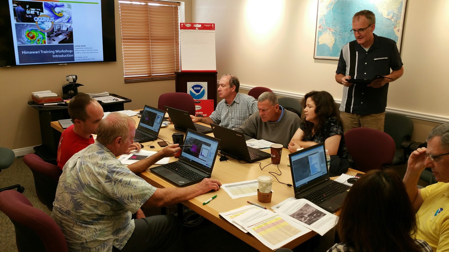 SSEC scientists Scott Lindstrom (standing) and Kathy Strabala (fourth from right) instructing meteorologists at the U.S. National Weather Service forecast office in Guam, 16-19 November 2015. Credit: Jordan Gerth, SSEC.